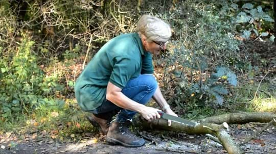 Volunteer Joanne Yellen sawing a branch