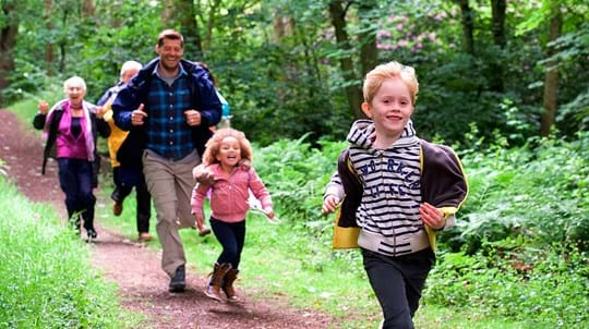 Family running along path, Big Wood, Runcorn