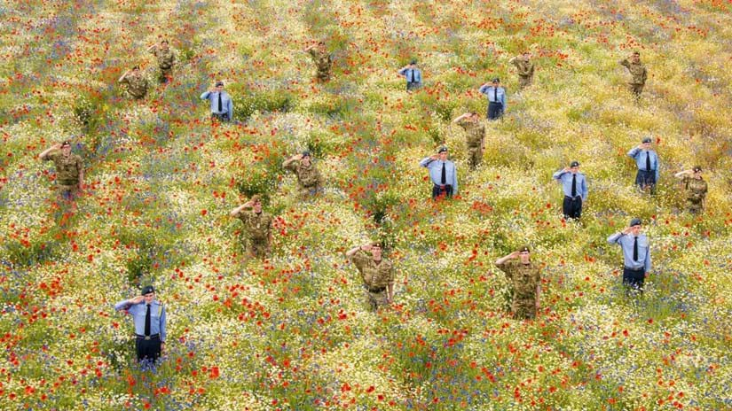 Cadets standing to attention among poppies at Heartwood Forest