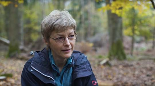 Volunteer Hilary Hinks in a wood talking to camera