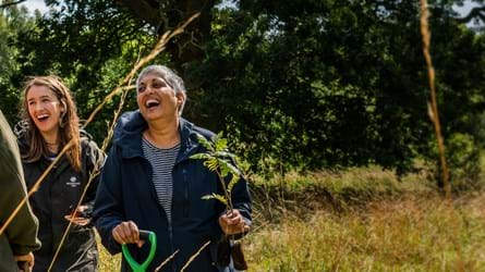 Two women planting trees for the Big Climate Fightback