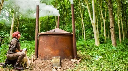 Charcoal kiln in the woods