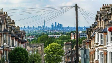 View looking to the City of London down a residential street showing urban trees